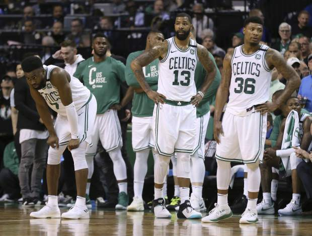 Boston Celtics players stand near the bench near the end of the second half in Game 7 of the NBA basketball Eastern Conference finals against the Cleveland Cavaliers, Sunday, May 27, 2018, in Boston. (AP Photo/Elise Amendola)