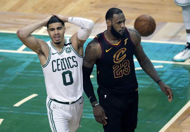 Boston Celtics forward Jayson Tatum, left, reacts in front of Cleveland Cavaliers forward LeBron James during the second half in Game 7 of the NBA basketball Eastern Conference finals, Sunday, May 27, 2018, in Boston. (AP Photo/Charles Krupa)