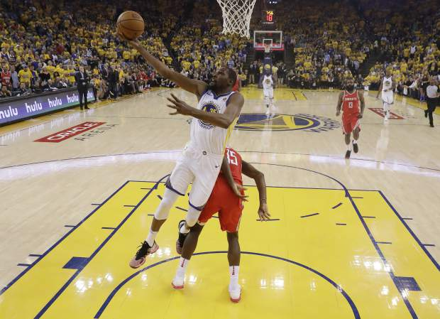 Golden State Warriors' Kevin Durant drives to the basket against the Houston Rockets during the first half in Game 3 of the NBA basketball Western Conference Finals Sunday, May 20, 2018, in Oakland, Calif. (AP Photo/Marcio Jose Sanchez)