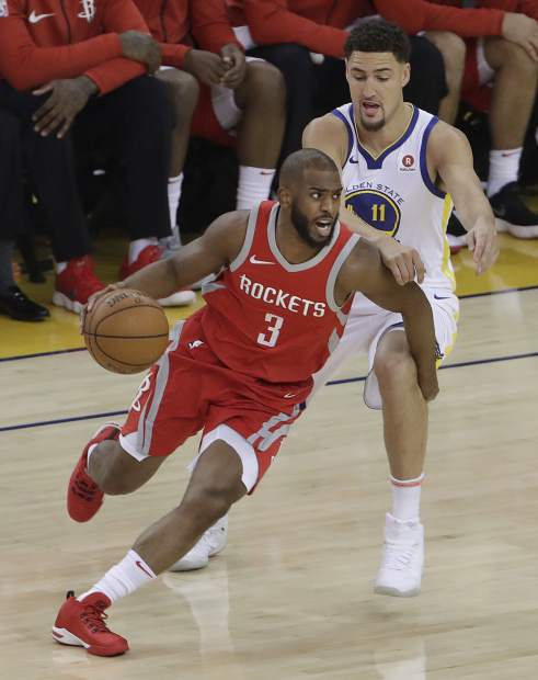 Houston Rockets guard Chris Paul (3) dribbles past Golden State Warriors guard Klay Thompson (11) during the first half of Game 3 of the NBA basketball Western Conference Finals in Oakland, Calif., Sunday, May 20, 2018. (AP Photo/Jeff Chiu)