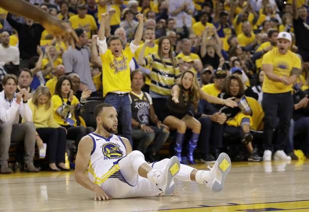 Golden State Warriors guard Stephen Curry (30) reacts after scoring against the Houston Rockets during the second half of Game 3 of the NBA basketball Western Conference Finals in Oakland, Calif., Sunday, May 20, 2018. (AP Photo/Marcio Jose Sanchez)