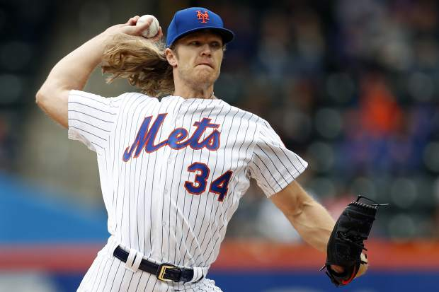 New York Mets starting pitcher Noah Syndergaard delivers during the first inning of a baseball game against the Colorado Rockies on Sunday, May 6, 2018, in New York. (AP Photo/Adam Hunger)
