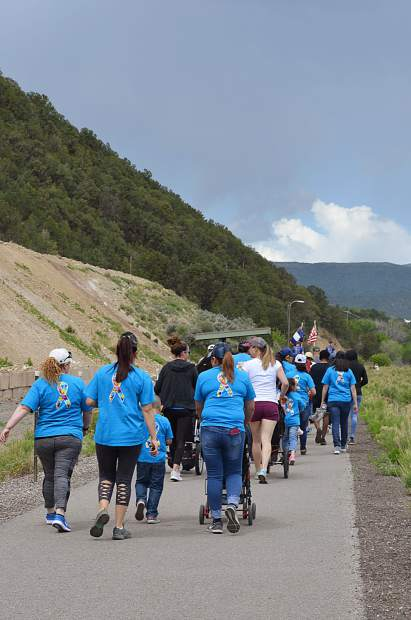 Community members walk for autism during the third annual GO Autism 5K hosted by the Smiling Goat Ranch in Carbondale.