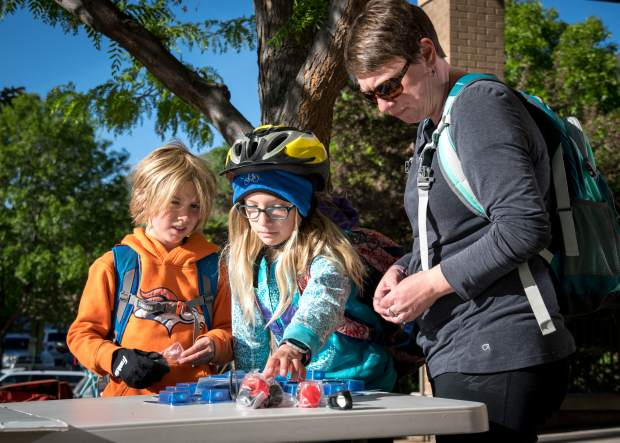 Sam, Brighton and Ashley Hathaway pick up free bike repair kits and bike lights on National Bike to Work Day in front of Glenwood Springs City Hall on Friday morning.