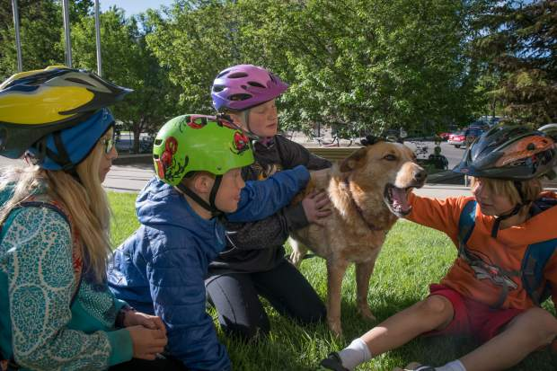 Henry and Maisie Smith hang out with dog Buckley with friends Sam and Brighton Hathaway on National Bike to Work Day.