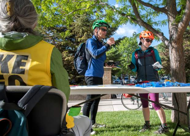 Bikers pick up free bike repair kits and enjoy free coffee and breakfast foods in front of Glenwood Springs City Hall on National Bike to Work Day, which took place on Friday.