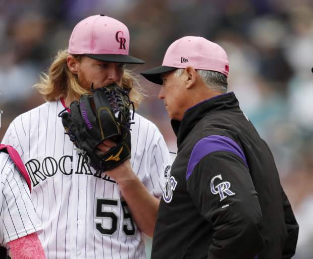 Colorado Rockies starting pitcher Jon Gray, left, confers with manager Bud Black who visits the mound after Gray gave up a single to Milwaukee Brewers' Jonathan Villar in the third inning of a baseball game Sunday, May 13, 2018, in Denver. (AP Photo/David Zalubowski)