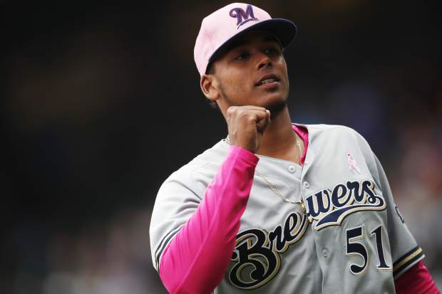 Milwaukee Brewers starting pitcher Freddy Peralta gestures as he heads to the dugout after being pulled from the mound following his strikeout of the Colorado Rockies' Charlie Blackmon in the sixth inning.
