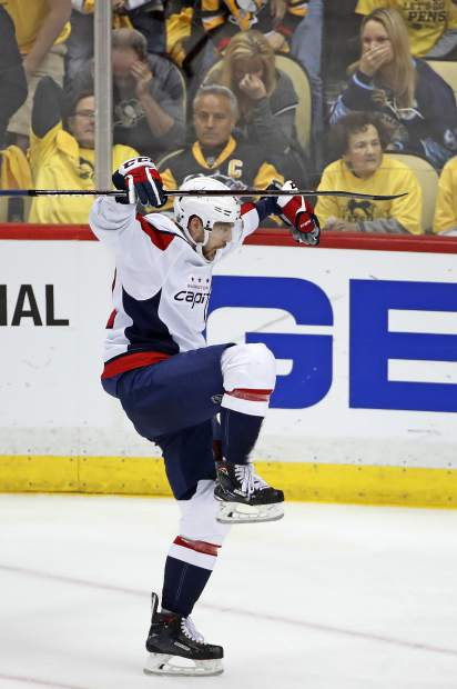 Washington Capitals' Evgeny Kuznetsov (92) celebrates his game-winning goal during the overtime period in Game 6 of an NHL second-round hockey playoff series against the Pittsburgh Penguins in Pittsburgh, Monday, May 7, 2018. The Capitals won 2-1 to win the series, four games to two. (AP Photo/Gene J. Puskar)