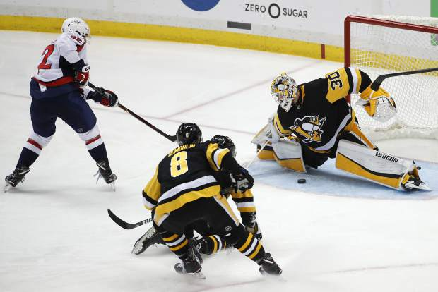 Washington Capitals' Evgeny Kuznetsov (92) gets the game-winning goal between the pads of Pittsburgh Penguins goaltender Matt Murray (30) during the overtime period in Game 6 of an NHL second-round hockey playoff series in Pittsburgh, Monday, May 7, 2018. The Capitals won 2-1 to win the series, four games to two. (AP Photo/Gene J. Puskar)