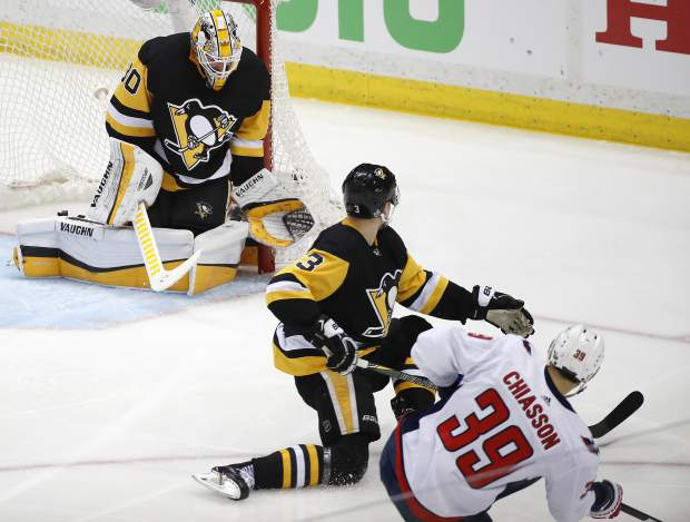Washington Capitals' Alex Chiasson (39) gets the puck past Pittsburgh Penguins goaltender Matt Murray (30) and Olli Maatta (3) for a goal during the second period in Game 6 of an NHL second-round hockey playoff series, Monday, May 7, 2018. AP Photo/Gene J. Puskar)
