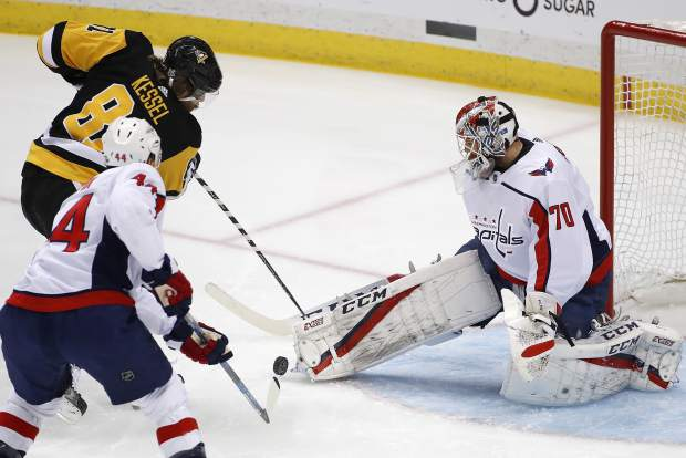 Washington Capitals goaltender Braden Holtby (70) stops a shot by Pittsburgh Penguins' Phil Kessel (81) during the first period in Game 6 of an NHL second-round hockey playoff series in Pittsburgh, Monday, May 7, 2018. (AP Photo/Gene J. Puskar)