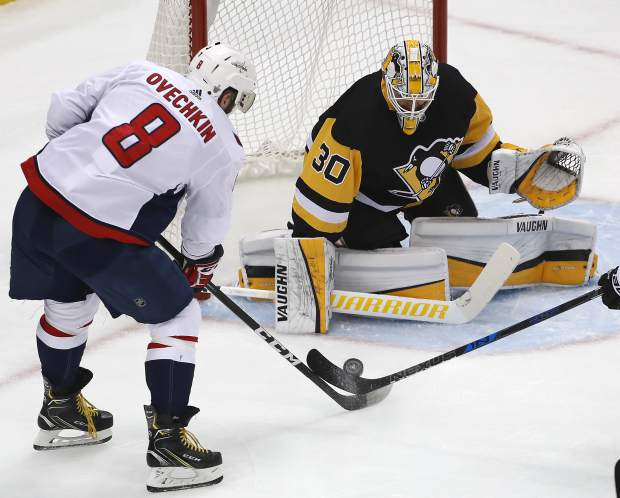 Washington Capitals' Alex Ovechkin (8) has a shot stopped by Pittsburgh Penguins goaltender Matt Murray (30) during the first period in Game 6 of an NHL second-round hockey playoff series in Pittsburgh, Monday, May 7, 2018. (AP Photo/Gene J. Puskar)