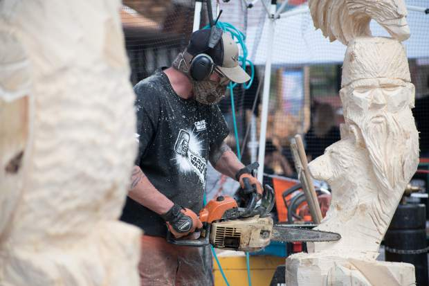 Carve Wars participant Joe Srholez works on his competition piece the