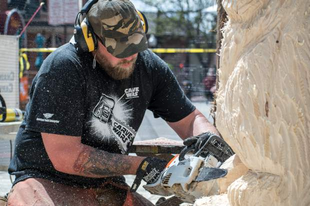 Carve Wars participant Joe Wenal works on his compeition piece the