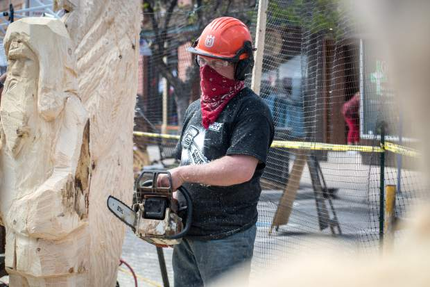 Carve Wars participant Johnny Busby works on his competition piece the