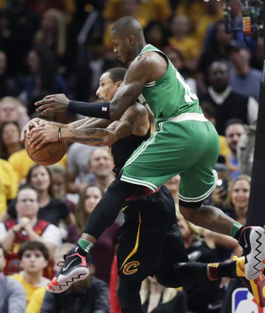 Cleveland Cavaliers' George Hill grabs a rebound against Boston Celtics' Terry Rozier in the second half of Game 4 of the NBA basketball Eastern Conference finals, Monday, May 21, 2018, in Cleveland. (AP Photo/Tony Dejak)