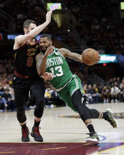 Boston Celtics' Marcus Morris (13) drives on Cleveland Cavaliers' Kevin Love (0) in the second half of Game 4 of the NBA basketball Eastern Conference finals, Monday, May 21, 2018, in Cleveland. (AP Photo/Tony Dejak)