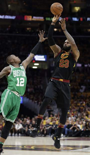 Cleveland Cavaliers' LeBron James (23) shoots over Boston Celtics' Terry Rozier (12) in the first half of Game 4 of the NBA basketball Eastern Conference finals Monday, May 21, 2018, in Cleveland. (AP Photo/Tony Dejak)