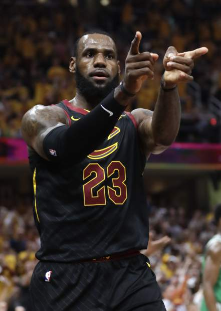Cleveland Cavaliers' LeBron James (23) reacts after a play against the Boston Celtics in the first half of Game 4 of the NBA basketball Eastern Conference finals, Monday, May 21, 2018, in Cleveland. (AP Photo/Tony Dejak)