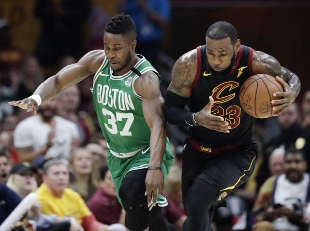 Cleveland Cavaliers' LeBron James (23) steals the ball from Boston Celtics' Semi Ojeleye (37) in the first half of Game 4 of the NBA basketball Eastern Conference finals Monday, May 21, 2018, in Cleveland. (AP Photo/Tony Dejak)