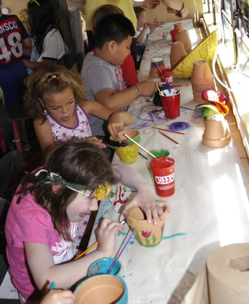 The Rosybelle makerspace art bus was a popular place for youngsters to decorate planting pots in time for Mother's Day.
