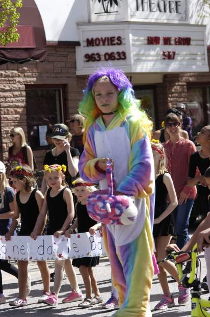 Natasha Zucco was all rainbows high atop her stilts in the Parade of the Species, the official kickoff to Saturday's Dandelion Day in Carbondale.