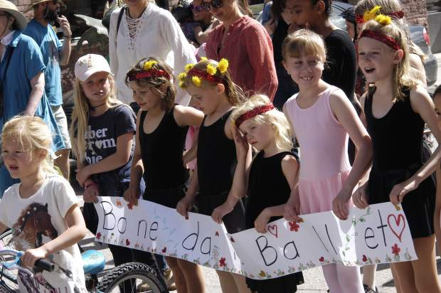 Members of the Bonedale Ballet group helped lead the Parade of the Species at Dandelion Day in Carbondale on Saturday morning.