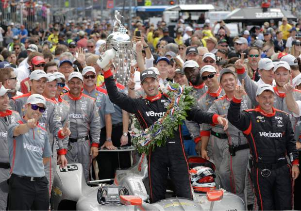 Will Power, of Australia, celebrates after winning the Indianapolis 500 auto race at Indianapolis Motor Speedway, in Indianapolis Sunday.