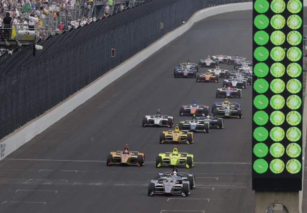 Will Power, of Australia, leads the field on a restart late in the Indianapolis 500 auto race on his way to wining at Indianapolis Motor Speedway in Indianapolis, Sunday, May 27, 2018. (AP Photo/R Brent Smith)