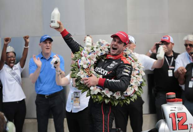 Will Power, of Australia, celebrates after winning the Indianapolis 500 auto race at Indianapolis Motor Speedway in Indianapolis, Sunday, May 27, 2018. (AP Photo/AJ Mast)