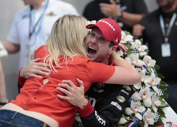 Will Power, of Australia, celebrates with his wife Liz after winning the Indianapolis 500 auto race at Indianapolis Motor Speedway, in Indianapolis Sunday, May 27, 2018. (AP Photo/AJ Mast)