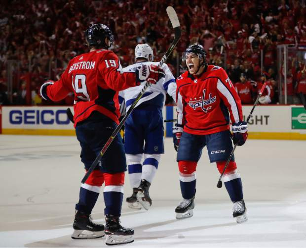 Washington Capitals right wing T.J. Oshie (77) celebrates his goal against the Tampa Bay Lightning with teammate Washington Capitals center Nicklas Backstrom (19), from Sweden, during the second period of Game 6 of the NHL Eastern Conference finals hockey playoff series, Monday, May 21, 2018, in Washington. Skating away is Tampa Bay Lightning left wing Alex Killorn (17). (AP Photo/Pablo Martinez Monsivais)