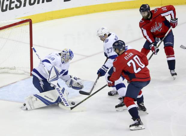 Tampa Bay Lightning goaltender Andrei Vasilevskiy (88) blocks a shot as defenseman Ryan McDonagh (27) comes in to assist while Washington Capitals center Lars Eller (20) and right wing Brett Connolly (10) look on during the first period in Game 6 of the Eastern Conference hockey final of the Stanley Cup Playoffs Monday, May 21, 2018 in Washington. (Dirk Shadd/The Tampa Bay Times via AP)