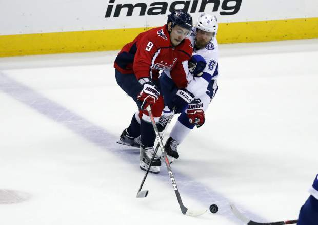 Washington Capitals defenseman Dmitry Orlov (9), from Russia, and Tampa Bay Lightning defenseman Anton Stralman (6), from Sweden, battle for the puck during the first period of Game 6 of the NHL Eastern Conference finals hockey playoff series Monday, May 21, 2018, in Washington. (AP Photo/Alex Brandon)