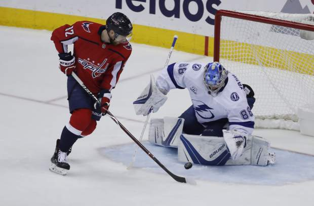 Washington Capitals center Evgeny Kuznetsov (92), from Russia, has his shot blocked by Tampa Bay Lightning goaltender Andrei Vasilevskiy (88), from Russia, during the first period of Game 6 of the NHL Eastern Conference finals hockey playoff series, Monday, May 21, 2018, in Washington. (AP Photo/Alex Brandon)