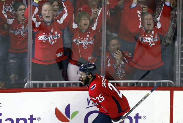 Washington Capitals right wing Devante Smith-Pelly (25) celebrates his goal during the third period of Game 6 of the NHL Eastern Conference finals hockey playoff series against the Tampa Bay Lightning, Monday, May 21, 2018, in Washington. The Capitals won 3-0. (AP Photo/Alex Brandon)