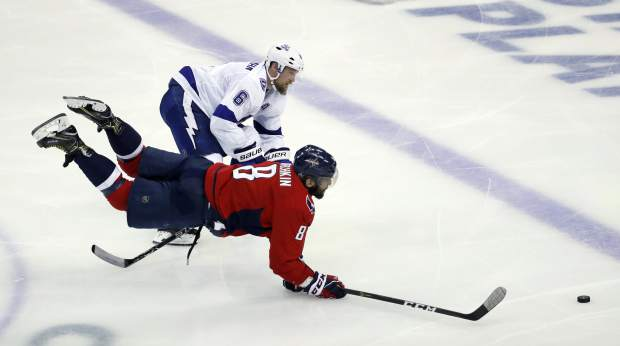 Washington Capitals left wing Alex Ovechkin (8), from Russia, lunges for the puck as Tampa Bay Lightning defenseman Anton Stralman (6), from Sweden, defends during the third period of Game 6 of the NHL Eastern Conference finals hockey playoff series, Monday, May 21, 2018, in Washington. The Capitals won 3-0. (AP Photo/Alex Brandon)