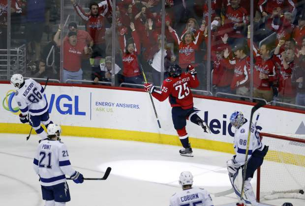 Washington Capitals right wing Devante Smith-Pelly (25) celebrates his goal past Tampa Bay Lightning goaltender Andrei Vasilevskiy (88), from Russia, during the third period of Game 6 of the NHL Eastern Conference finals hockey playoff series, Monday, May 21, 2018, in Washington. The Capitals won 3-0. (AP Photo/Alex Brandon)