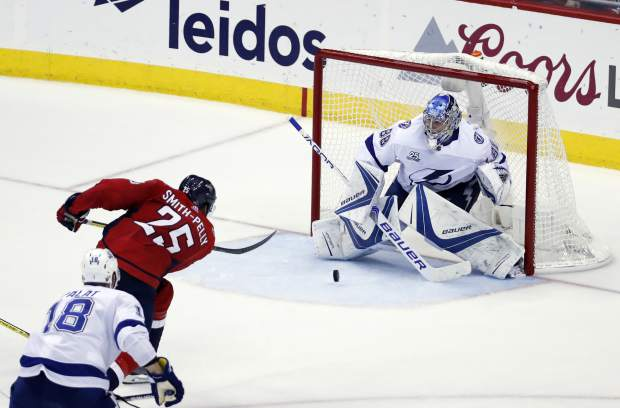 Washington Capitals right wing Devante Smith-Pelly (25) scores a goal past Tampa Bay Lightning goaltender Andrei Vasilevskiy (88), from Russia, during the third period of Game 6 of the NHL Eastern Conference finals hockey playoff series, Monday, May 21, 2018, in Washington. The Capitals won 3-0. (AP Photo/Alex Brandon)