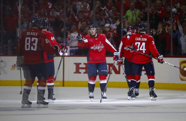 Washington Capitals right wing T.J. Oshie, center, celebrates with teammates after scoring during the third period of Game 6 of the NHL Eastern Conference finals hockey playoff series against Tampa Bay Lightning, Monday, May 21, 2018, in Washington. Capitals won 3-0. (AP Photo/Pablo Martinez Monsivais)