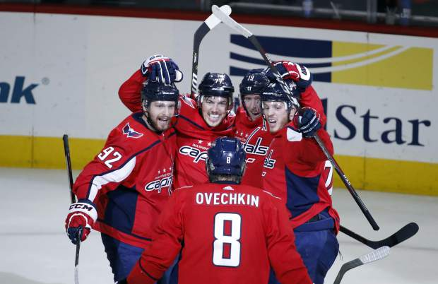 Washington Capitals left wing Alex Ovechkin (8), from Russia, comes to join center Evgeny Kuznetsov, left, from Russia, right wing T.J. Oshie, center Nicklas Backstrom (19), from Sweden, and defenseman John Carlson as they celebrate a goal by Oshie during the second period of Game 6 of the NHL Eastern Conference finals hockey playoff series against the Tampa Bay Lightning, Monday, May 21, 2018, in Washington. (AP Photo/Alex Brandon)