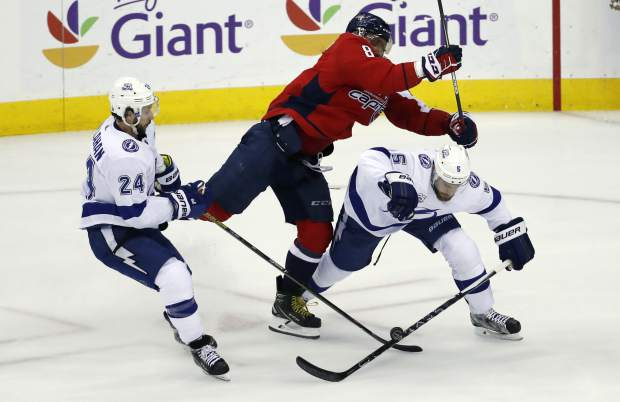 Washington Capitals left wing Alex Ovechkin (8), from Russia, hits Tampa Bay Lightning defenseman Dan Girardi (5) with Lightning right wing Ryan Callahan (24) nearby during the first period of Game 6 of the NHL Eastern Conference finals hockey playoff series Monday, May 21, 2018, in Washington. (AP Photo/Alex Brandon)