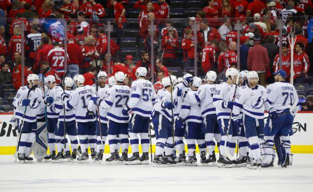 Members of the Tampa Bay Lightning celebrate on the ice at the end of Game 4 of the NHL Eastern Conference finals hockey playoff series against Washington Capitals on Thursday, May 17, 2018, in Washington. Tampa Bay won 4-2. (AP Photo/Pablo Martinez Monsivais)
