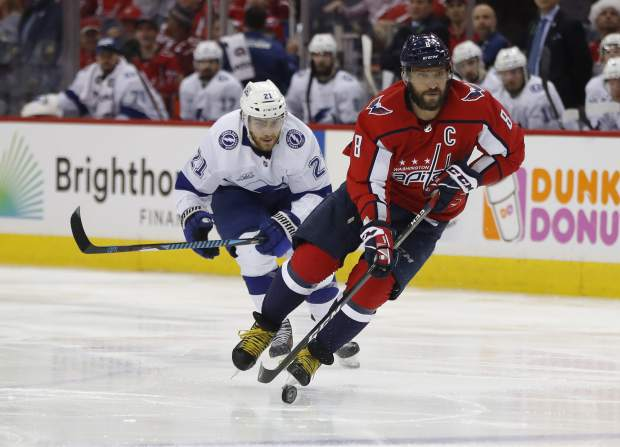 Washington Capitals left wing Alex Ovechkin (8), skates past Tampa Bay Lightning center Brayden Point (21) during the second period of Game 4 of the NHL Eastern Conference finals hockey playoff series Thursday, May 17, 2018, in Washington. (AP Photo/Pablo Martinez Monsivais)