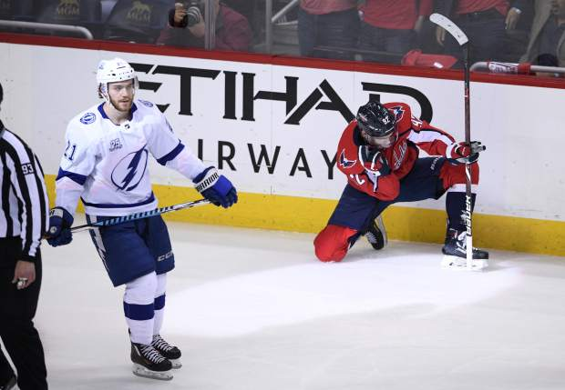 Washington Capitals center Evgeny Kuznetsov (92), of Russia, celebrates his goal as Tampa Bay Lightning center Brayden Point (21) skates by during the second period of Game 4 of the NHL hockey Eastern Conference finals Thursday, May 17, 2018, in Washington. (AP Photo/Nick Wass)