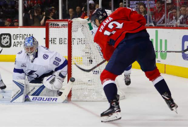 Tampa Bay Lightning goaltender Andrei Vasilevskiy (88) stops a shot by Washington Capitals left wing Jakub Vrana (13) during the second period of Game 4 of the NHL Eastern Conference finals hockey playoff series, Thursday, May 17, 2018, in Washington. (AP Photo/Pablo Martinez Monsivais)