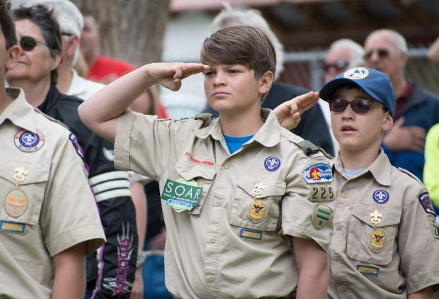 Members of Boy Scout Troop 225 salute the flag during the lowering of the colors during Monday's Memorial Day ceremony at Rosebud Cemetery.