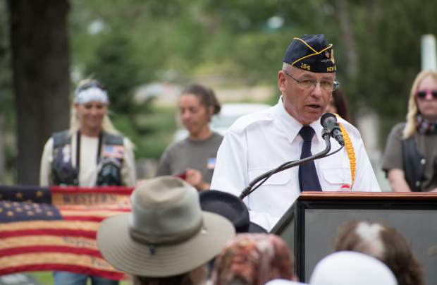 Greg Bak of the Western Slope Veterans Coalition addresses the audience during Monday's Memorial Day ceremony at Rosebud Cemetery.