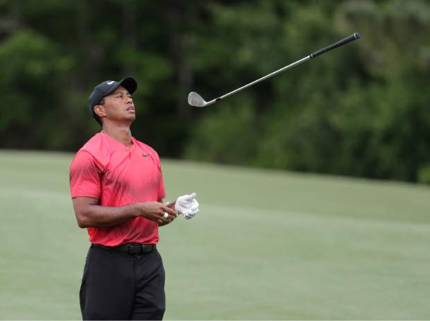 Tiger Woods throws his club in frustration on the 14 fairway, during the final round of The Players Championship golf tournament Sunday, May 13, 2018, in Ponte Vedra Beach, Fla. (AP Photo/)
